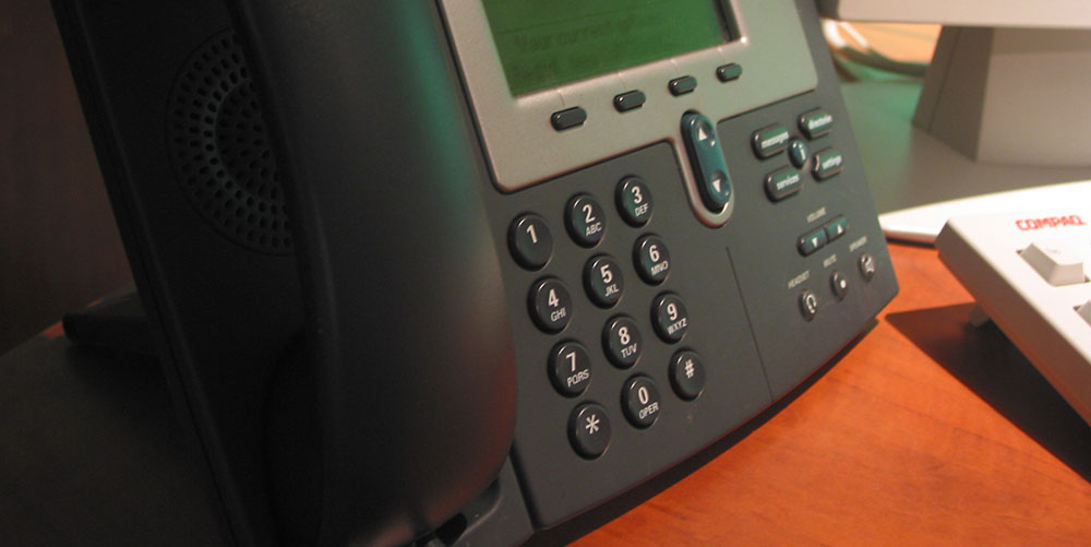 office VOIP phone rests on a desk